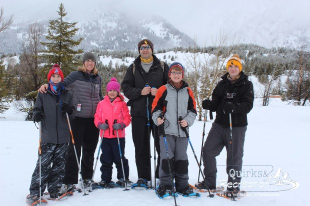 family photo in snowy Grand Teton National Park
