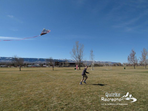 Boy running with kite - joy in a staycation