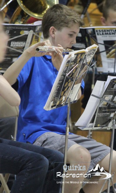 boy playing flute in a concert band