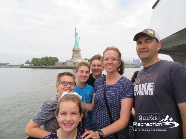 Family selfie with the Statue of Liberty