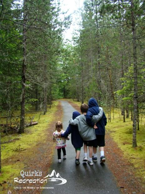 children walking in a forest