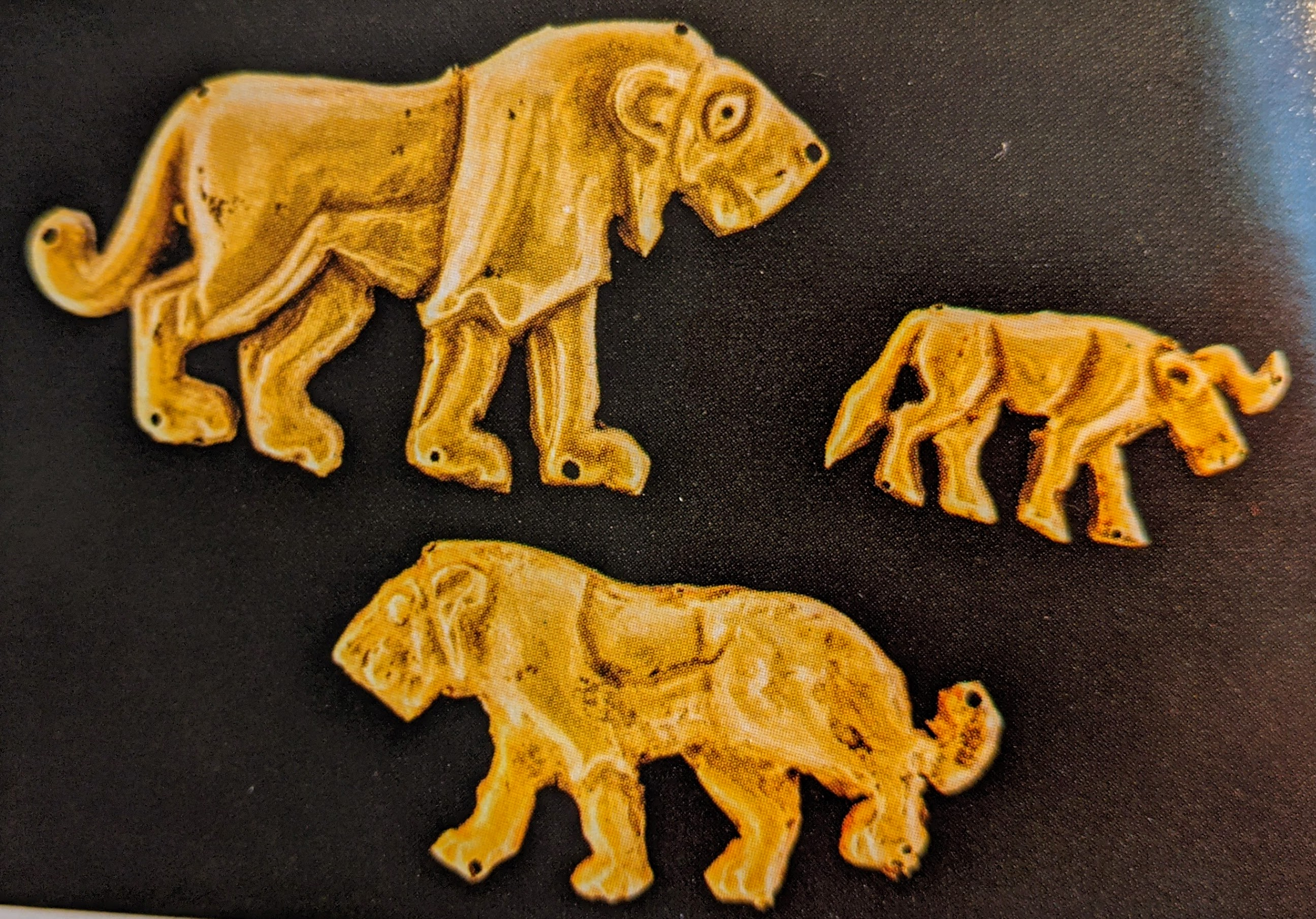 Lion and bull gold plaques