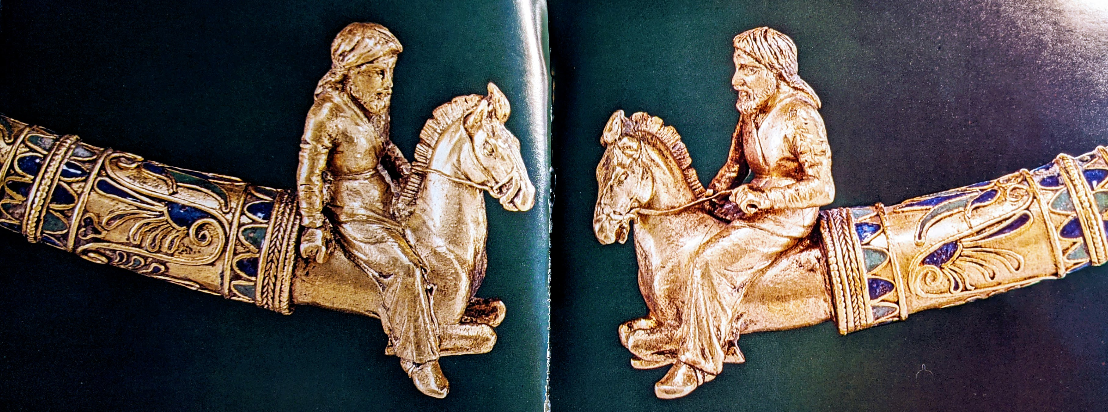 Torque with horse riders finials