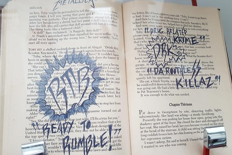 Book defaced by an inmate at Addington Jail