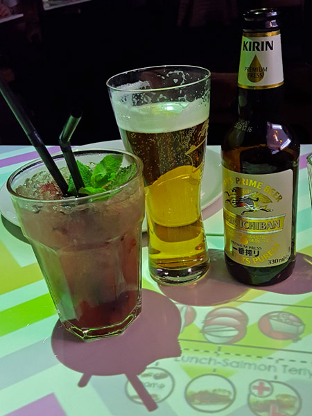 Cocktail and beer on the interactive tables at Japanese/Korean restaurant, Inamo in Soho, London