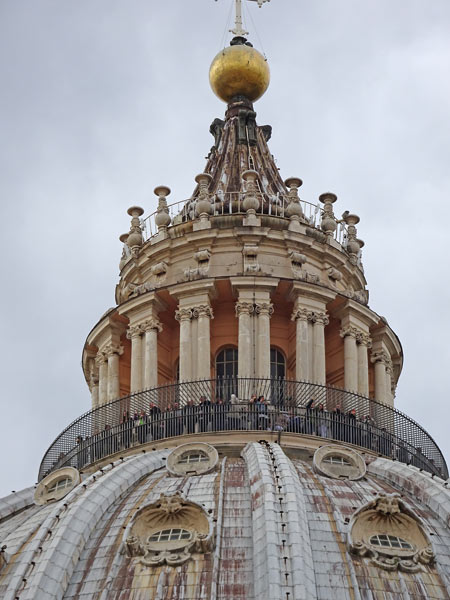 People standing at the highest point of the climb at the top of the dome (St Peter's Basilica)