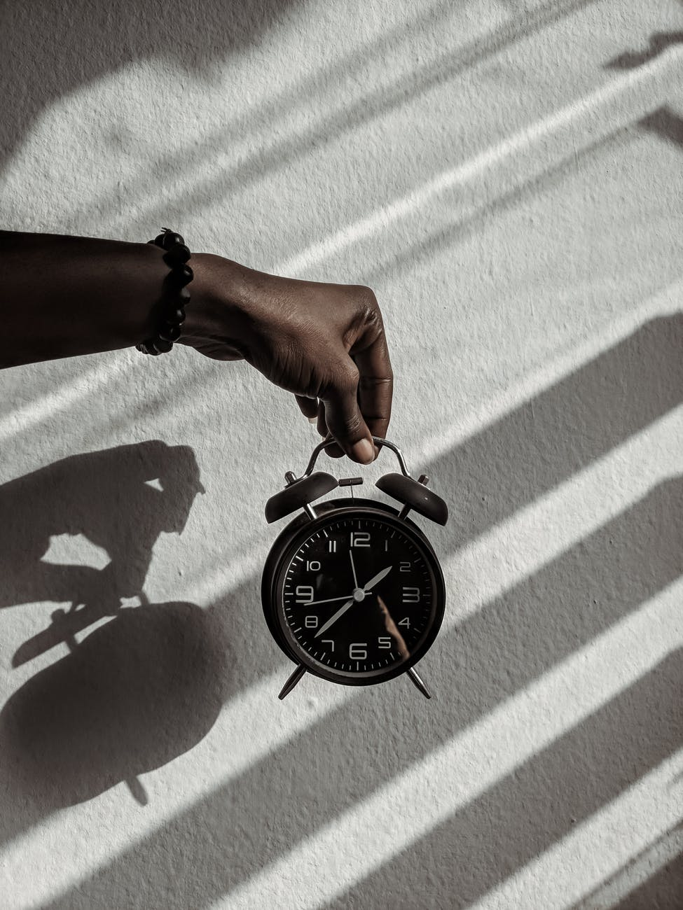person holding a alarm clock