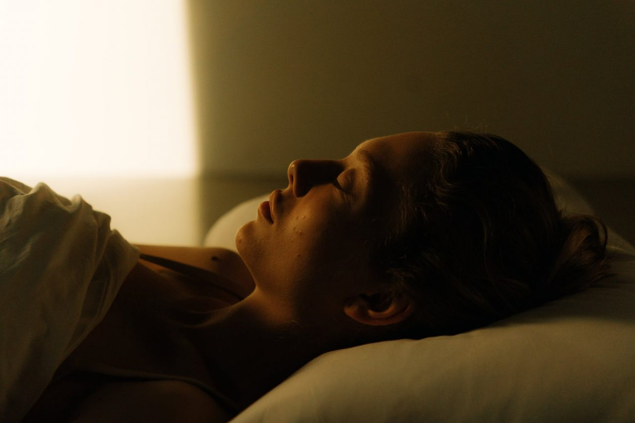 photo of a woman sleeping on the bed