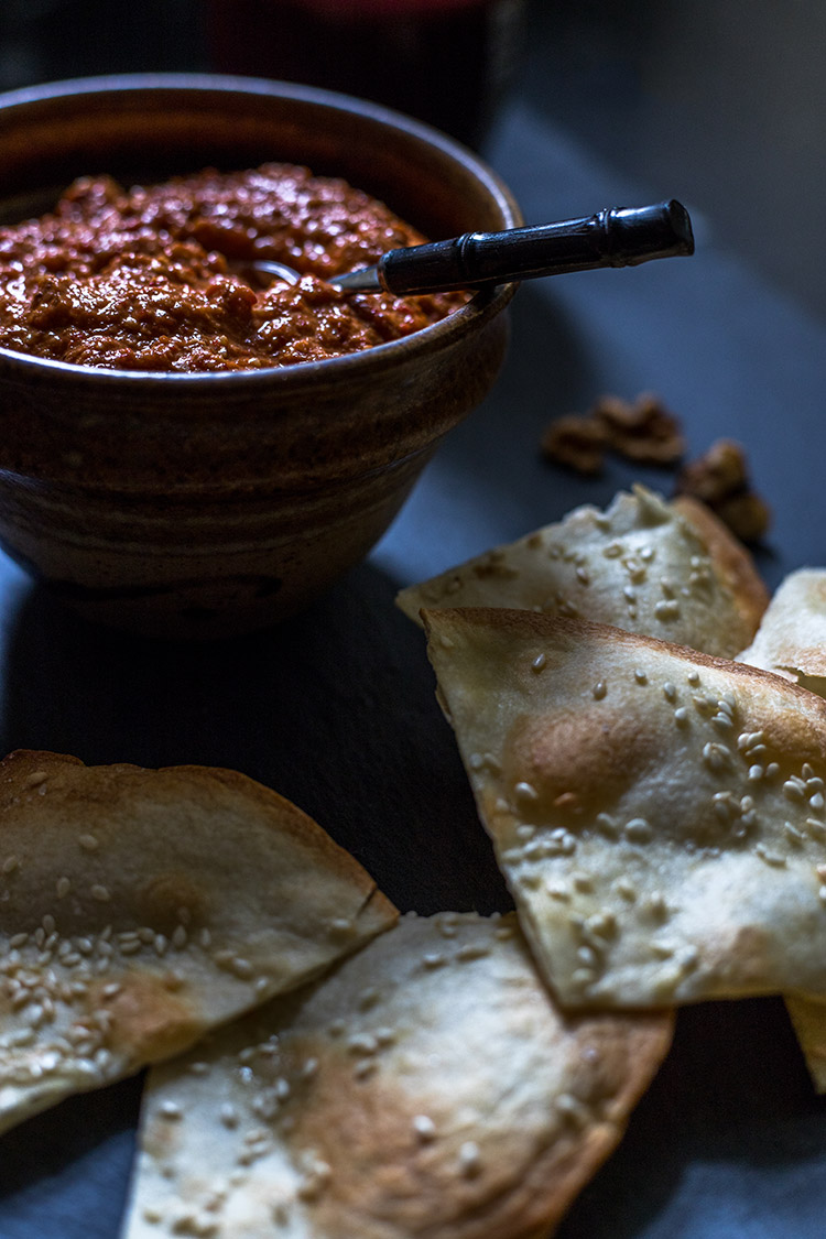 Muhammara red pepper and walnut dip, pictured with sesame crisps. Vegan and gluten free.
