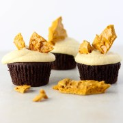 Chocolate cupcakes with caramel frosting and hokey pokey.