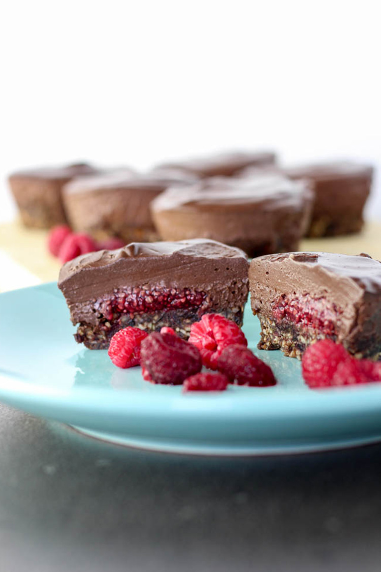 Mini chocolate and raspberry vegan cheesecakes.
