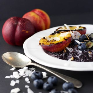 Black rice pudding with grilled nectarines.