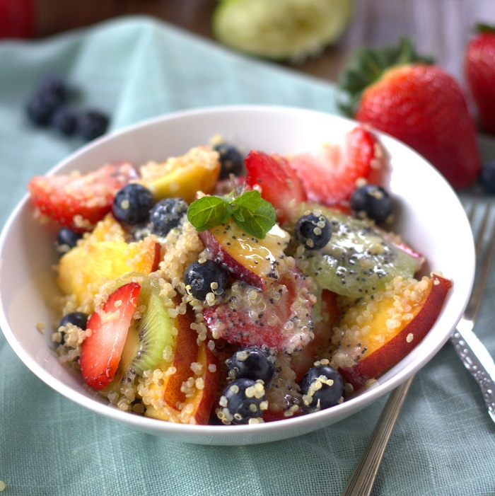 Summer fruit and quinoa salad with coconut ginger lime poppy seed dressing