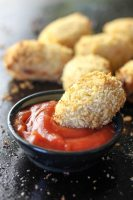 Tofu tater tots with tomato sauce (ketchup).