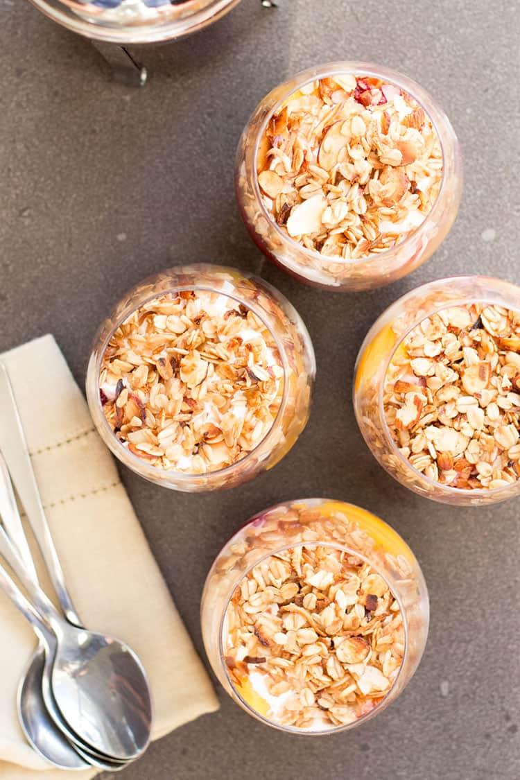 Peach melba breakfast trifle: peaches, raspberry chia jam, coconut yoghurt and granola layered with cake.