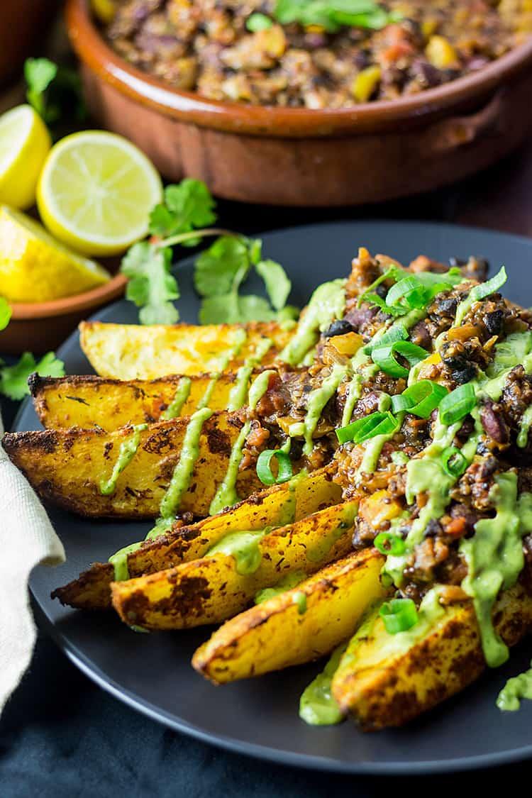 Cajun chili fries with avocado coriander sauce (vegan and gluten free).