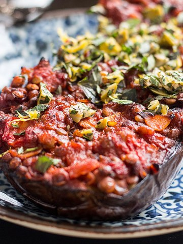 Baked eggplant with lentils, tomatoes and a herby topping (vegan, gluten free).