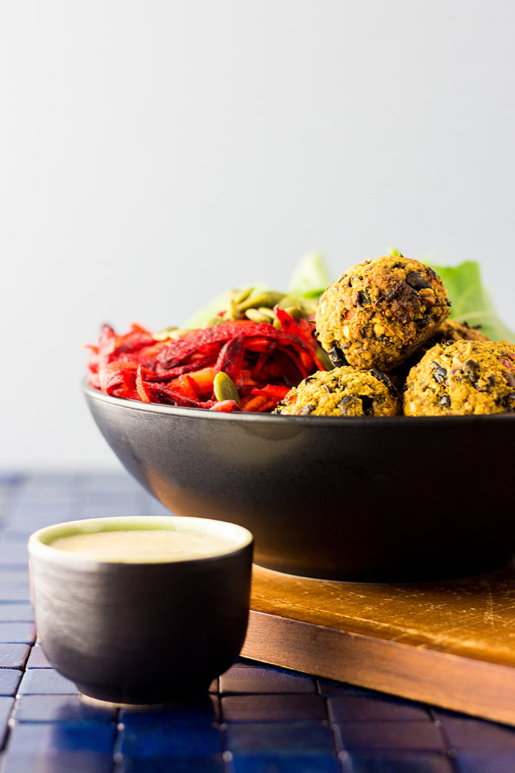 Vegan nourish bowl with beet salad and bean balls (gluten free).