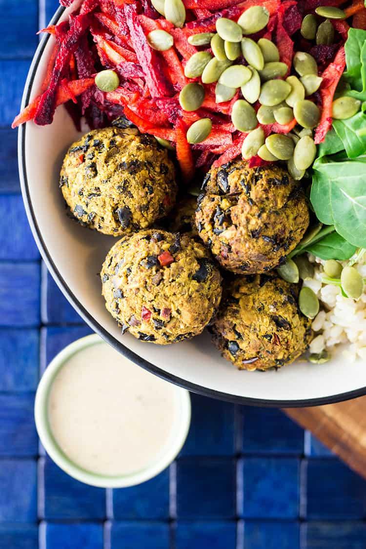 Vegan nourish bowl with beet salad and bean balls (gluten free).