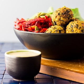 Vegan nourish bowl with beet salad and bean balls.