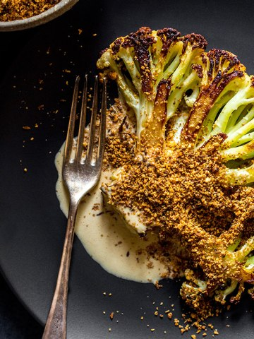 Cauliflower steak with orange tahini dressing and dukkah (vegan and gluten free).