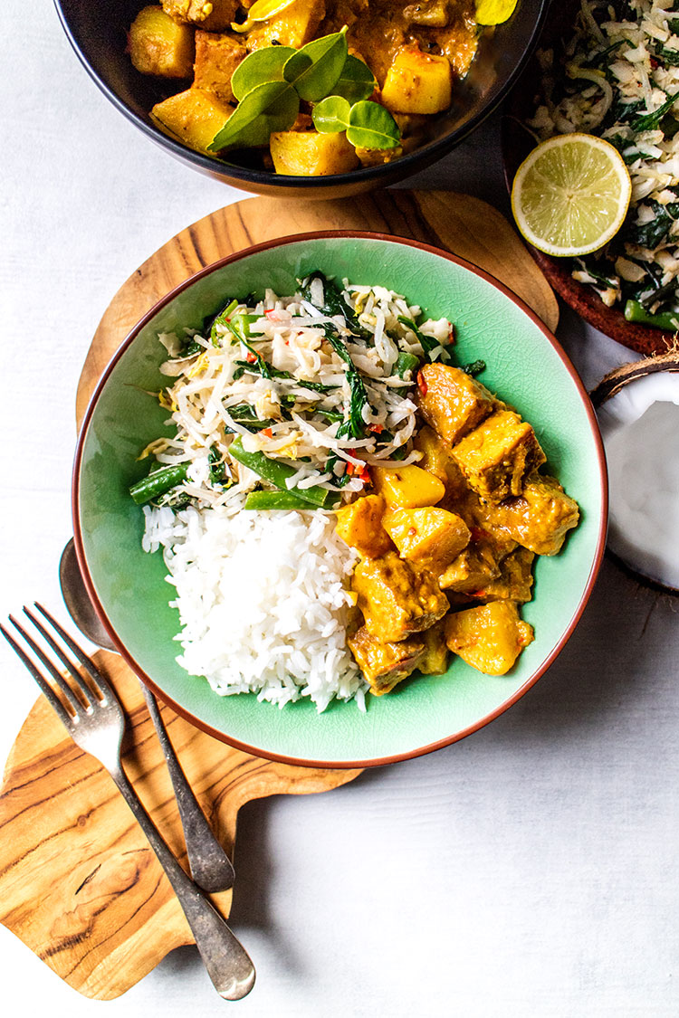 Balinese tempeh curry served with urab sayur (coconut and vegetable salad) and rice (vegan and gluten free).