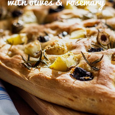 Try your hand at home made bread making with this pillowy soft Italian style potato foccacia topped with potato, olives and rosemary (vegan).
