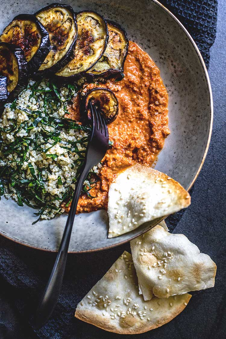 Quinoa, kale and eggplant bowl with muhammara (vegan and gluten free).