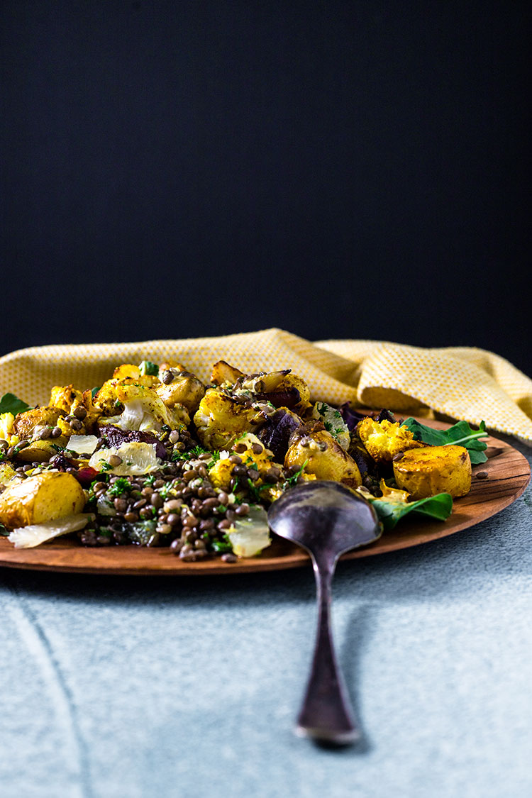 Potato, cauliflower and lentil salad on a serving platter.