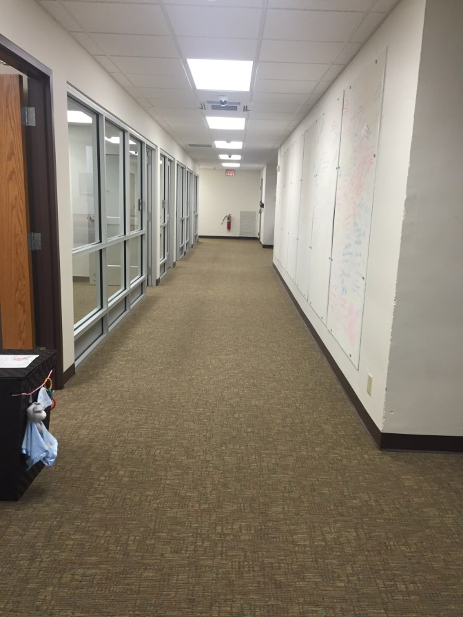 Hallway where board is located.