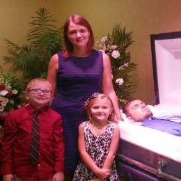 Happiness: woman at husband's casket