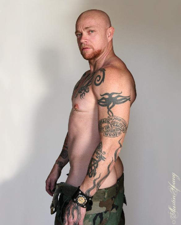 Awesome Buck Angel With His Banner Tattoo On Upper Sleeve