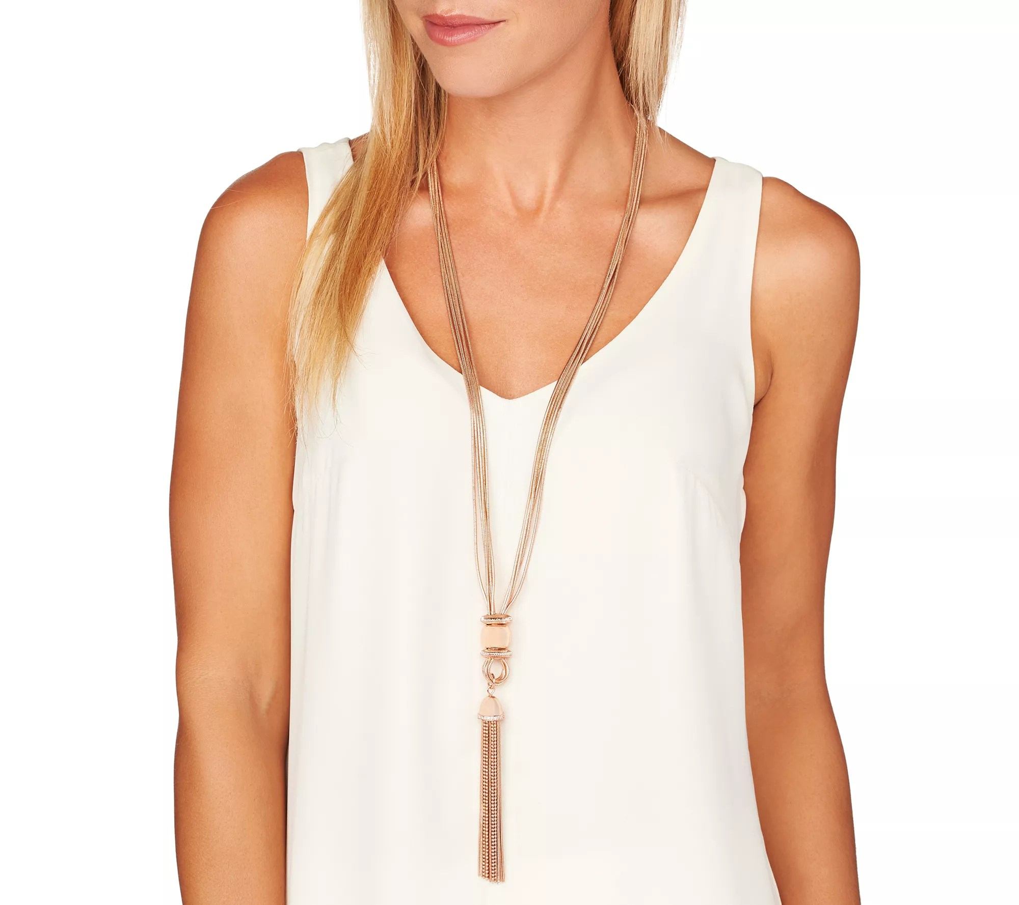 Pair with a blazer, and let the multi-strand snake chains, tassel drop, and clear crystal accents of this elegant necklace do the talking. Page 1 QVC.com