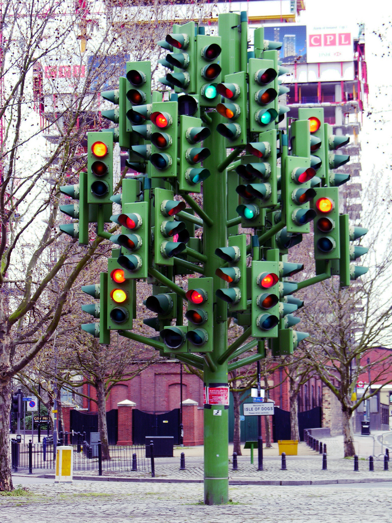"A ""tree"" sculpture featuring over a dozen traffic lights facing all directions"