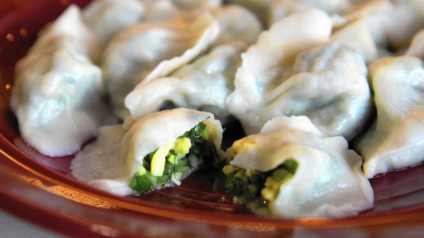 Boiled dumplings with shrimp and egg come 12 to an order. (Erin Hooley / Chicago Tribune)