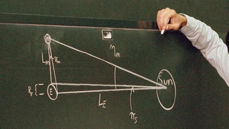 physics equation on blackboard