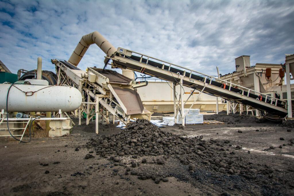 Recycled asphalt being sorted at an asphalt plant