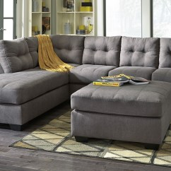 Chaise In Living Room Contemporary Rugs Rent Signature Design Maier 2 Piece Sectional Charcoal Furniture Rental Own