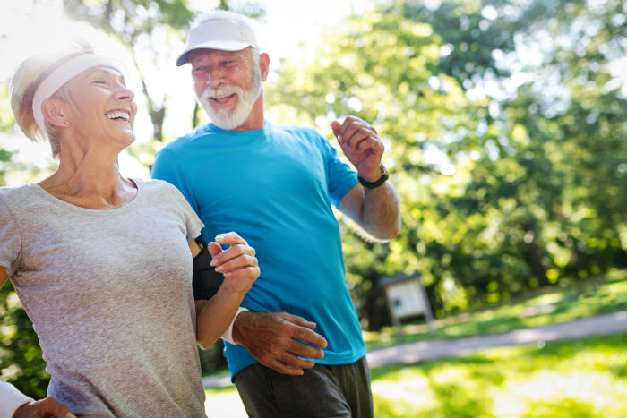 Elderly Durham couple jogging