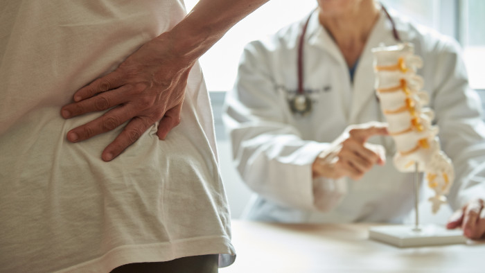 Cary man sees a doctor for back pain
