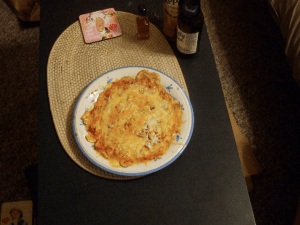 Our makeshift nacho cheese pizza. College life...