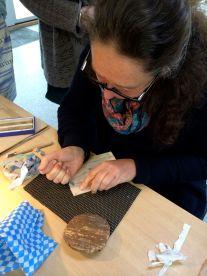 Sara demonstrating cutting