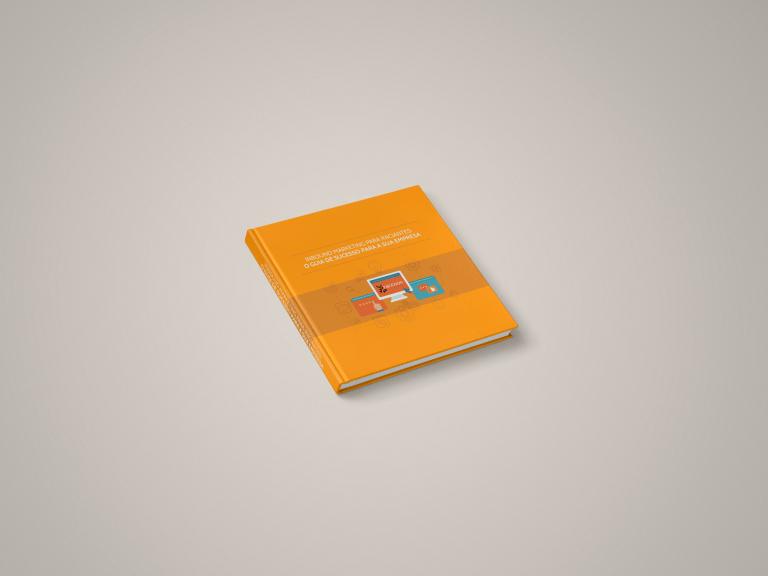 Fundo cinza com um livro laranja em destaque mostrando que o e-book é uma forma de co-marketing