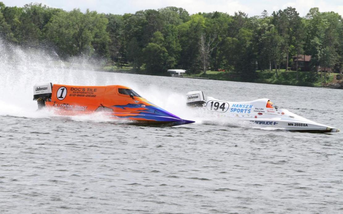 Dean Hansen (194) passes Tim Homeszyn (1) Sunday during the Twin Cities Power Boat Association's (TCPBA) power boat races on Serpent Lake at Crosby Memorial Park.jpg
