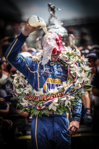Alexander Rossi with a cold shower of milk in Victory Circle following his win in the 100th Indianapolis 500 -- Photo by: Shawn Gritzmacher
