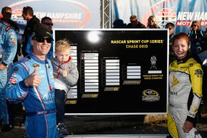 Kevin Harvick, driver of the #4 ditech Chevrolet, and his son, Keelan, place his name on the Chase Grid in Victory Lane after winning the NASCAR Sprint Cup Series Bad Boy Off Road 300 at New Hampshire Motor Speedway on September 25, 2016 in Loudon, New Hampshire. (Photo by Jeff Zelevansky/Getty Images)