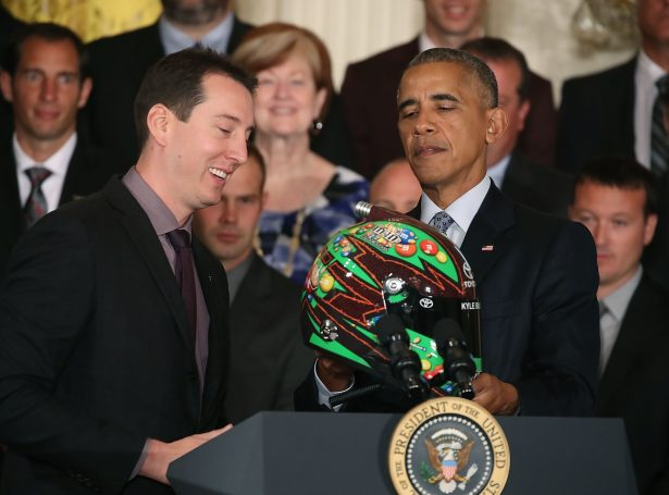 U.S. President Barack Obama (R), is presented with helmet from Sprint Cup Champion Kyle Busch during an event in the East Room at the White House, September 28, 2016 in Washington, DC. President Obama hosted the event to honor Kyle Busch and the Joe Gibbs Racing #18 car for their 2015 NASCAR Sprint Cup Series championship. (Photo by Mark Wilson/Getty Images)