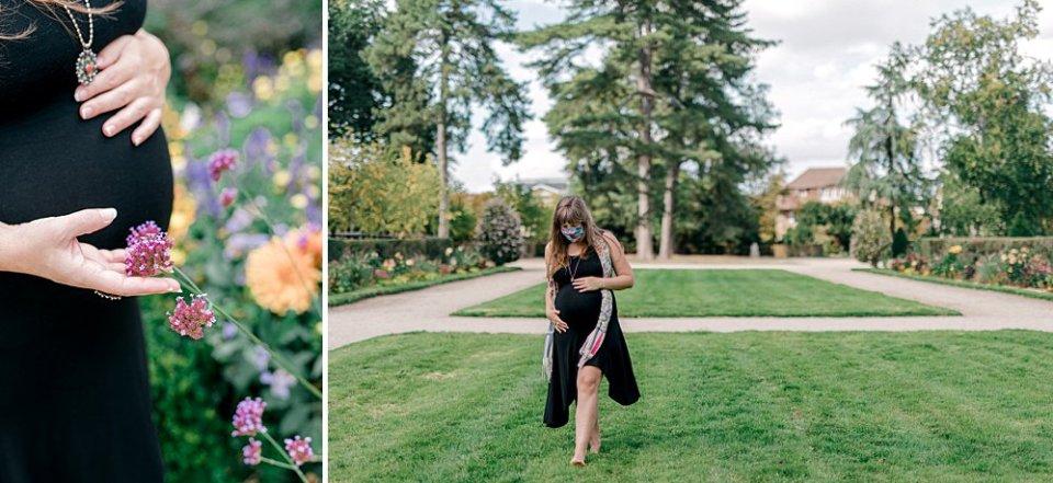 Masked pregnant woman in garden of Parc de Sceaux