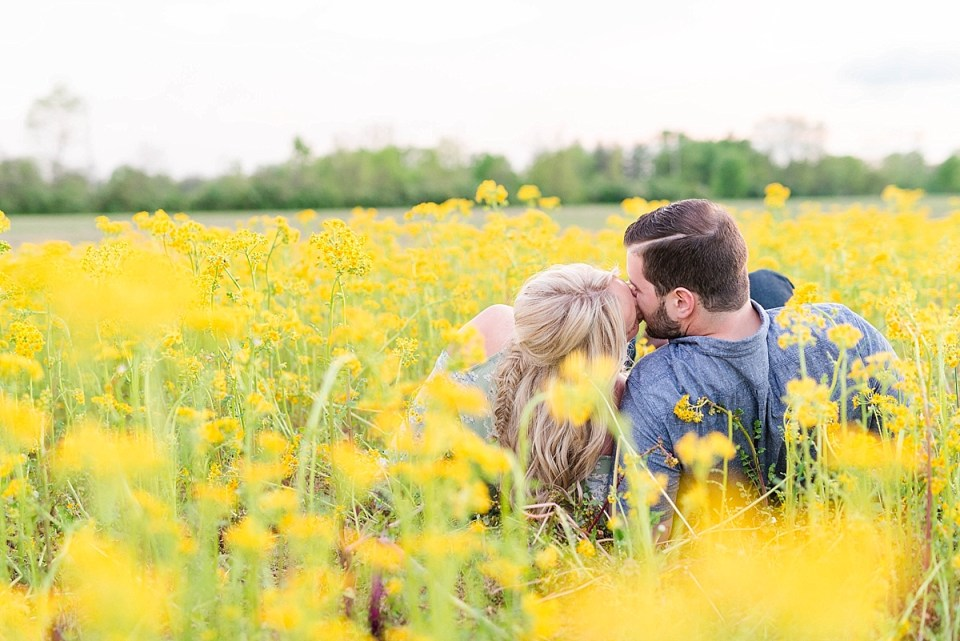 Couple laying in yellow flowers