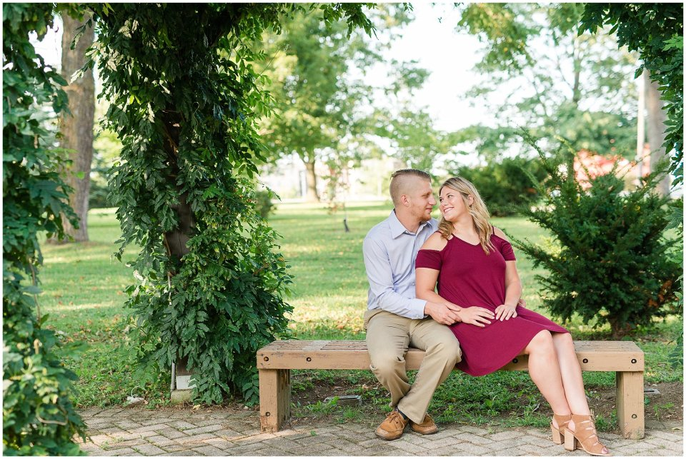 Engaged couple sitting on a bench in Winchester Kentucky